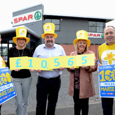 Peter McBride, right, McBride Retail Group, Brian McCallion, area manager, and Lynsey McCabe, second from left, Henderson Group, present a cheque for £10,565, the proceeds of the 1000 mile 'spinning'cycle in the 11 McBride Retail Group stores. Receiving the money is Sheena Havlin, Marie Curie local fundraising manager and Conor O'Kane, left, senior partnerships manager with Marie Curie. AN4343